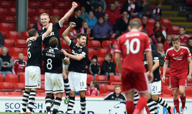 Chris Erskine punches the air as he celebrates his Pittodrie goal.