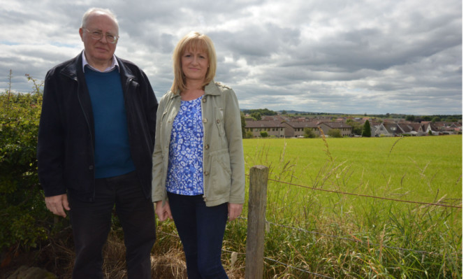Residents Tony Spence and Susan Coull at the site of the proposed houses.