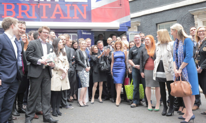Scottish television presenter and entrepreneur Carol Smillie, blue dress, with Prime Minister David Cameron, centre, at the Downing Street launch of the StartUp Britain tour.