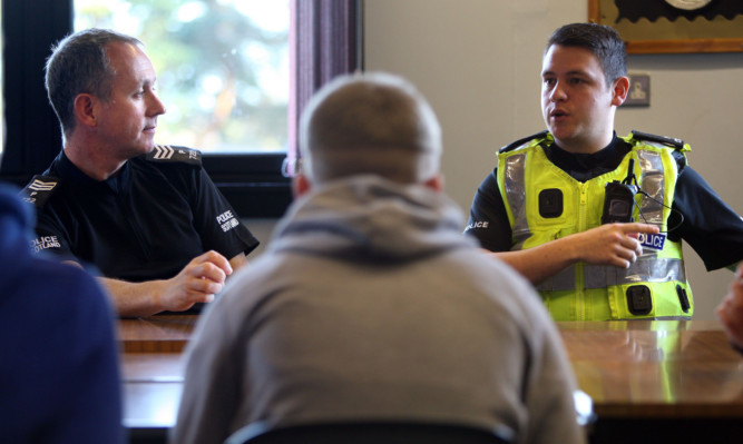 Sgt Neill and PC Duncan speaking to pupils at Kirkcaldy High School.