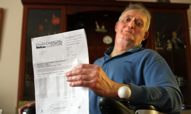 David White at his Dundee home with the demand from Dundee City Council.