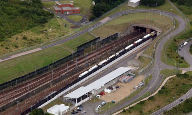 The Eurotunnel site in Folkestone, Kent, following a migrant death in the latest incursion on the Channel Tunnel in Calais. ... Calais migrant crisis ... 29-07-2015 ... Ashford ... UK ... Photo credit should read: Gareth Fuller/Unique Reference No. 23685819 ... Picture date: Wednesday July 29, 2015. The death comes as some 1,500 people were successful in breaching the fences at Calais last night, and 2,000 stormed the French terminal the night before. See PA story POLITICS Calais. Photo credit should read: Gareth Fuller/PA Wire