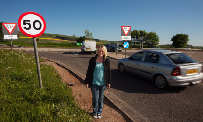 Campaigner Jill Fotheringham at the busy junction at Laurencekirk.