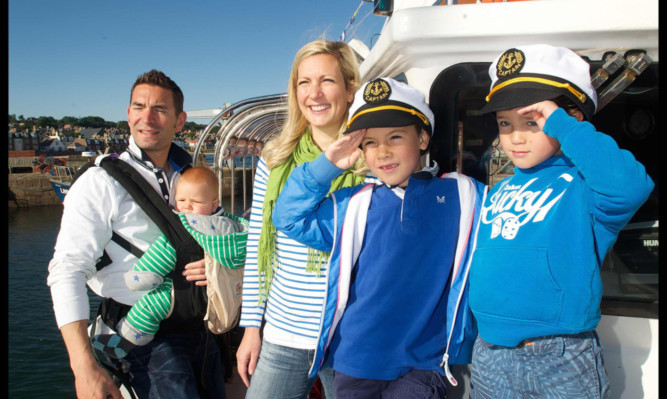 The Wharton family, dad Tsen with baby Harris, mum Emma, Laird, 7, and Radleigh, 5, on the new Forth ferry service.