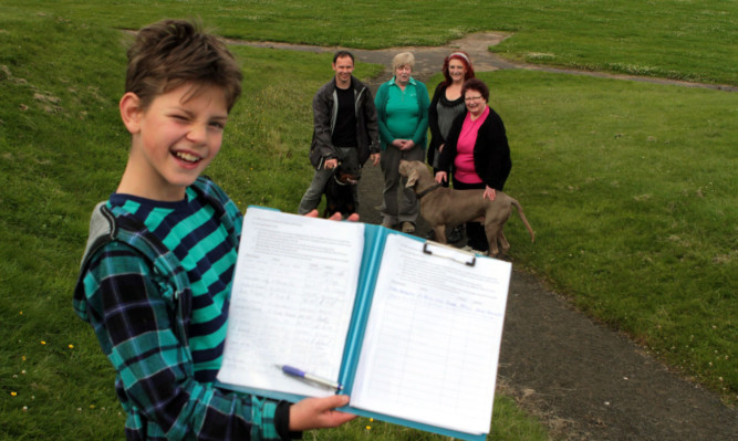 Eleven-year-old Alex Cragg with the petition and campaigners Graham Low, Jean Moir, Lynn Watson and Christine Mollison.