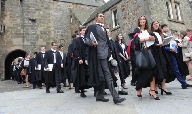 Graduating students from St Andrews University in St Salvators Quad, North Street in the town. Jenny says the Scottish Governments policy of free tuition fees for Scottish students is backfiring for those in the clearing system.
