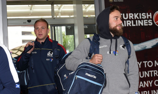Ruaridh Jackson (right) and fly half rival Greig Tonks leave for Dublin with the Scotland team yesterday.