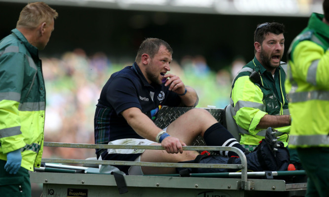 Scotlands Ryan Grant is stretchered off the pitch.