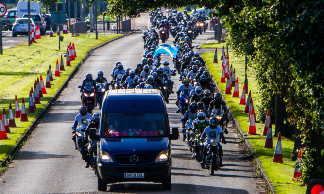 The convoy of bikers follows the van carrying Mr Lawsons body as it is taken from Dundee to Arbroath last week.