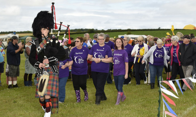 Piper Ben Anderson led the cancer survivors for an emotional lap of applause before the start of the Kirriemuir Relay for Life.