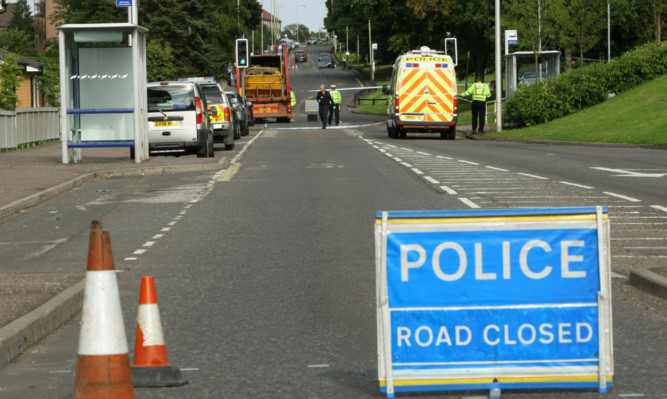 Police on South Road in Dundee after a girl was hit by a lorry