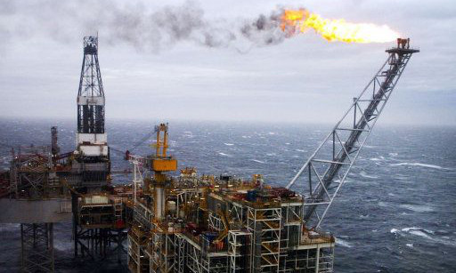 """Embargoed to 0001 Monday January 20  File photo dated 16/03/07 of an oil rig in the North Sea as a dwindling pool of engineering workers threatens a skills shortage in the oil and gas industry, a new report has warned. PRESS ASSOCIATION Photo. Issue date: Monday January 20, 2014. The trend is driving up pay to """"unprecedented"""" levels in some areas, said a report by technical advisers DNV GL. The outlook for the sector this year is positive, but a shortage of skilled employees will be the main barrier to growth, said the report. See PA story INDUSTRY Skills. Photo credit should read: Danny Lawson/PA Wire"""