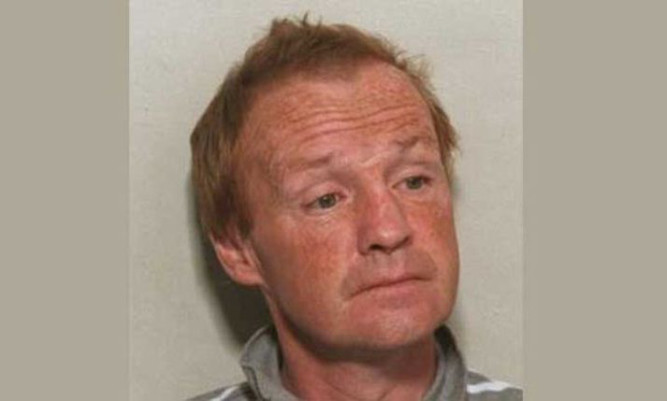 Michael Mearns was found with a serious head injury in the graveyard, off the Inverclyde town's South Street.