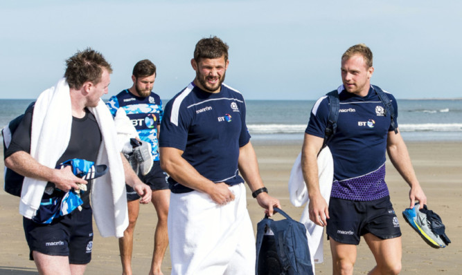 Ross Ford (centre) with Stuart Hogg and Greig Tonks after their recovery session in the sea on the West Sands at St Andrews.