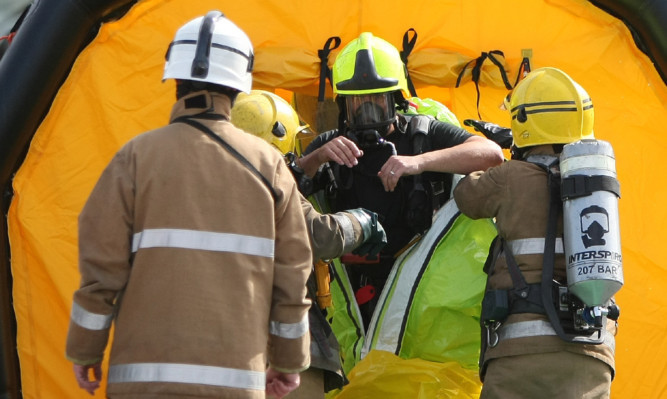 Firefighters donned protective suits to deal with Tuesday's leak.