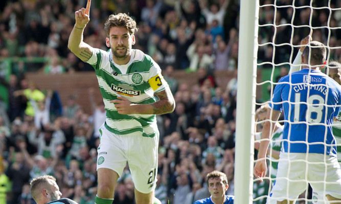 Alan Mannus is on the deck as Charlie Mulgrew scores Celtic's third.