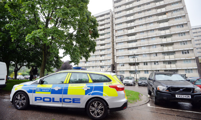 A police car parked outside Picardy House in Cedar Road, Enfield, where police shot a man dead after they were called to reports that a person armed with a firearm was making threats to kill.