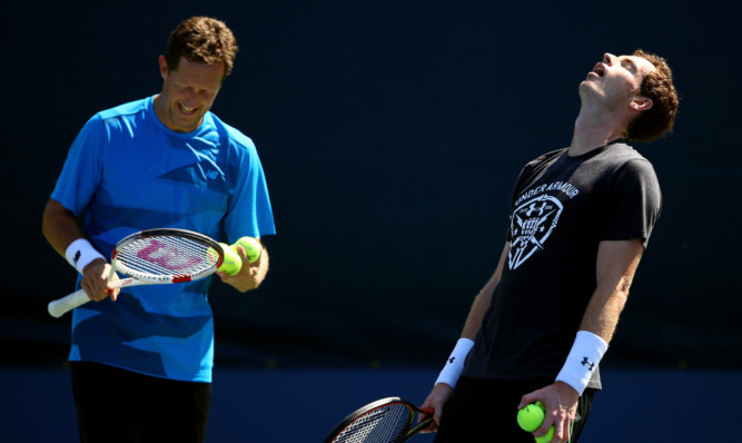Andy Murray feels the heat during practice with coach Jonas Bjorkman.