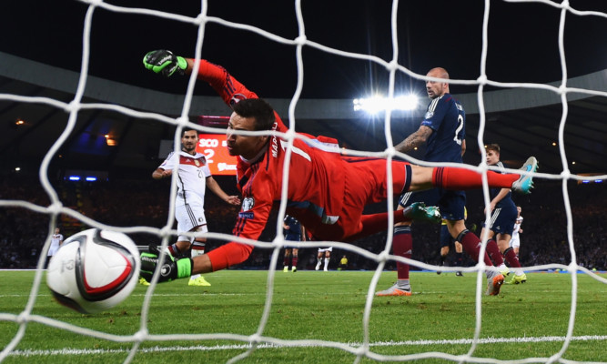 David Marshall sees Ilkay Guendogan's shot win the match for Germany.