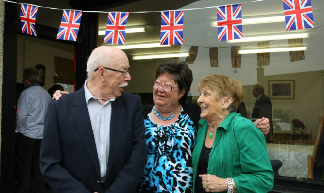 Ronnie and Frances Allan open the shop with Liz Dewar, centre, chairman of the trustees.