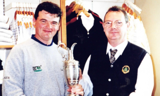 Mr Roy with the winner of the 1999 Open held at Carnoustie, Paul Lawrie.