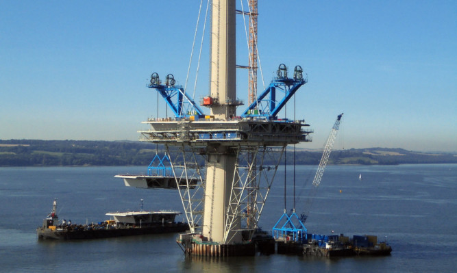The 800-tonne deck unit is being lifted into place on the Queensferry Crossing's north tower, as work has begun to lift the deck into place and fill in the gaps between its three 200 metre high towers.