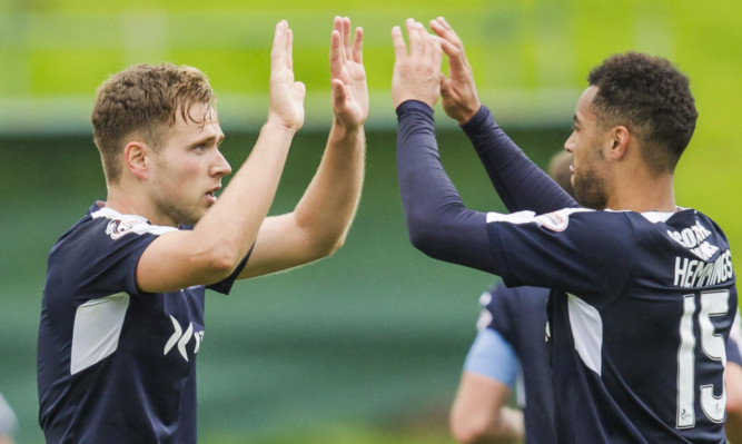 Dundee's Greg Stewart celebrates his goal with team-mate Kane Hemmings.