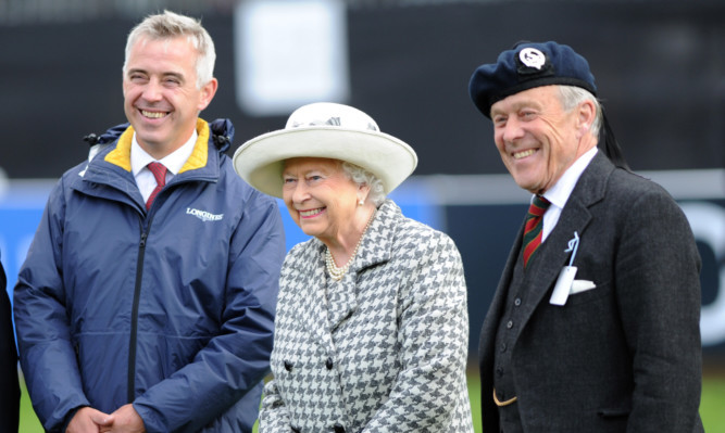 The Queen with event director Alec Lochore (leftr) and Lord Lieutenant Melville Jamieson.