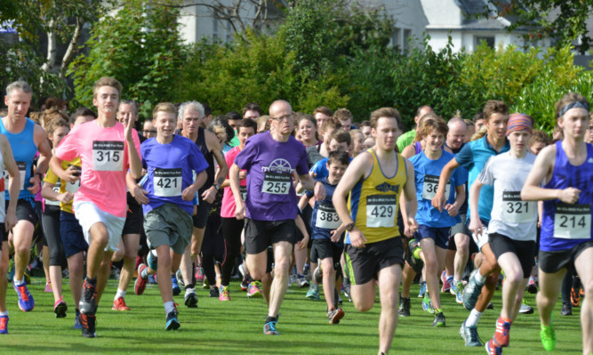 Some of those who took part in the 5km run at St Andrews University playing fields.