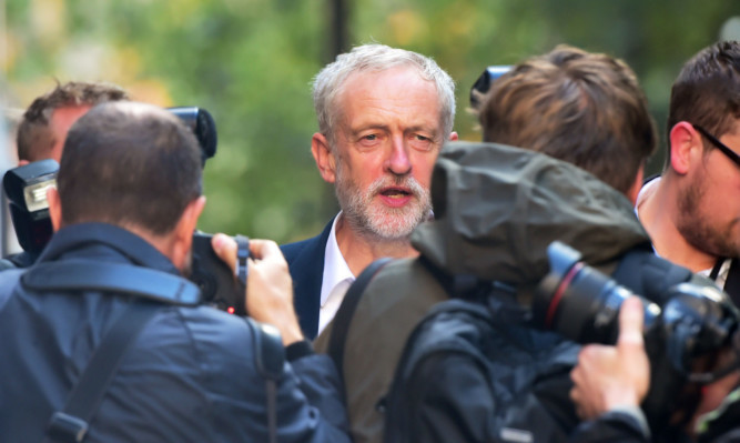 """Labour party leader Jeremy Corbyn leaves Labour party HQ in London, as he insisted he has created a """"unifying"""" and """"inclusive"""" shadow cabinet."""