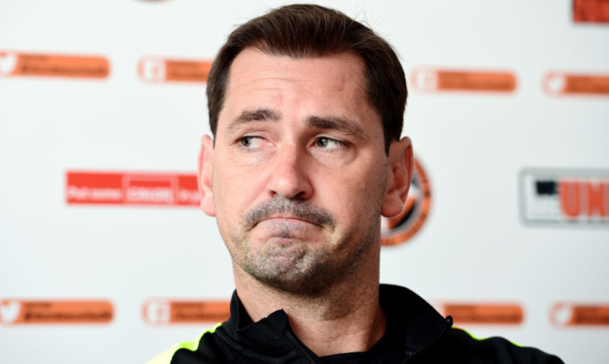 Jackie McNamara addresses the media.