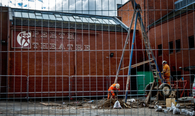 Workmen busy outside the theatre as renovation work proceeds apace.