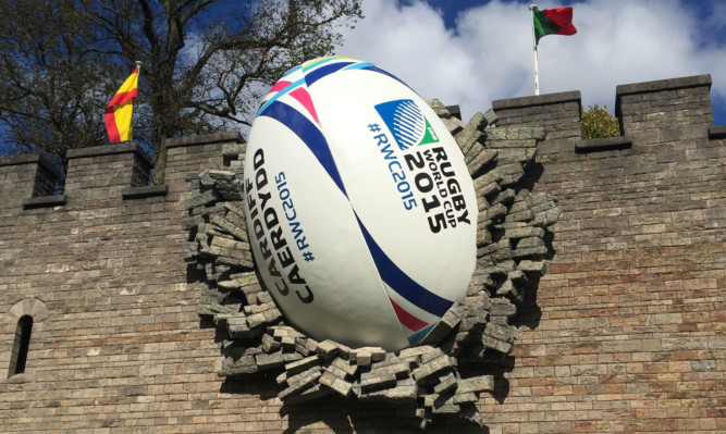 A giant rugby ball on the walls of Cardiff Castle to mark the start of the Rugby World Cup.