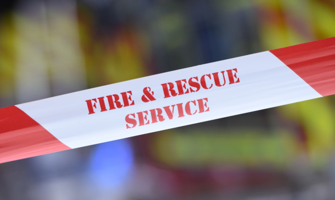08.05.15 - FOR FILE - pictured at the scene of the fire on Princes Street, Dundee is the Fire and Rescue Service cordon tape