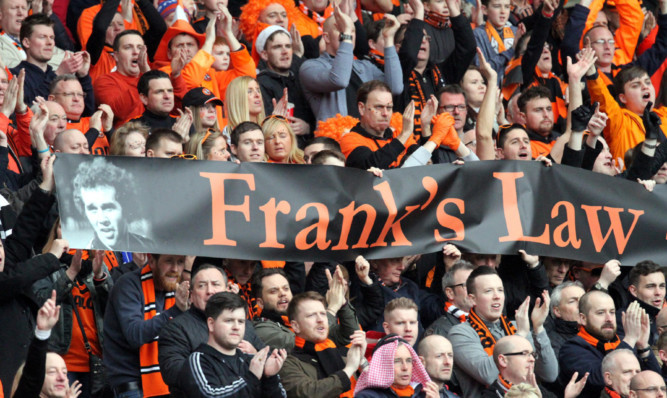 Dundee United fans joining in with the applause to back Frank's Law at Celtic Park.