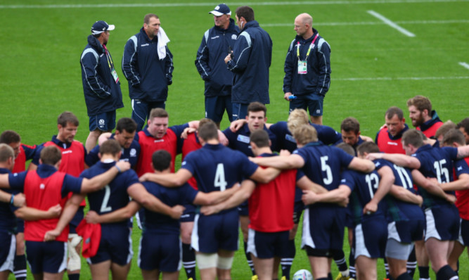 Vern Cotter (centre) and his assistants discuss matters at Scotland's final training session.