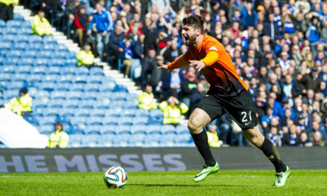 Nadir Ciftci celebrates before he scores at Ibrox in April 2014  - it represented a high-point for manager McNamara.