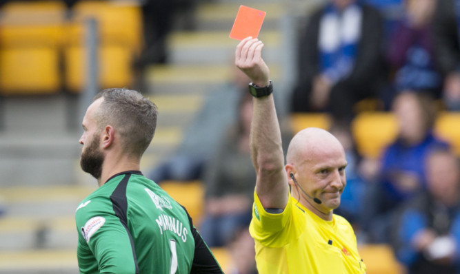 Alan Mannus is ordered off by Bobby Madden.