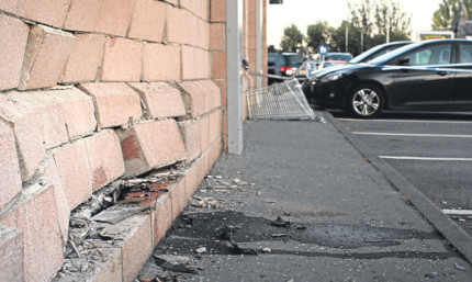 The damage caused to the wall of the Co-op.