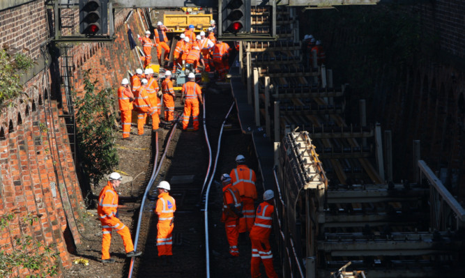 The site of the derailment has been a hive of activity.