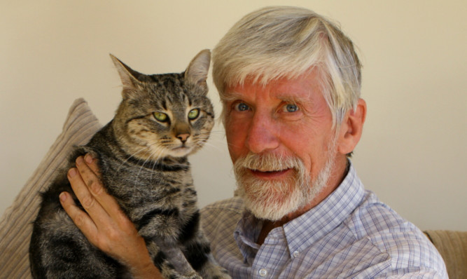 Mr Richards with well-loved Puss, who is on the mend.