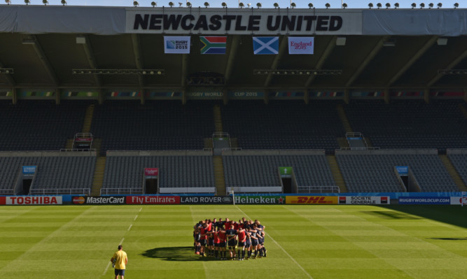 Scotland huddle together at their final run prior to today's game at St James' Park.