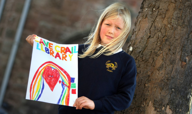 Crail Primary School pupil Attila Newey with her Save Crail Library poster.