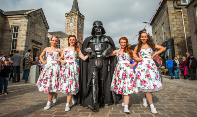 Dance troupe the Kennedy Cupcakes meets Darth Vader.