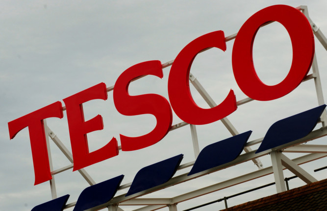 General view of Tesco supermarket logo in Ashby De La Zouch, Leicestershire. PRESS ASSOCIATION Photo. Picture date: Wednesday  August 1, 2012. See PA story. Photo credit should read: Rui Vieira/PA Wire