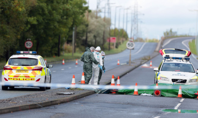 Police forensics at scene in Wallasey North Road, Wallasey, Merseyside, where Pc David Phillips was mown down and killed by a stolen car.