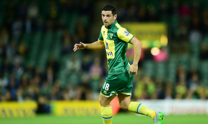 Norwich midfielder Graham Dorrans has been called up to the Scotland squad for the Euro 2016 qualifiers against Poland and Gibraltar.