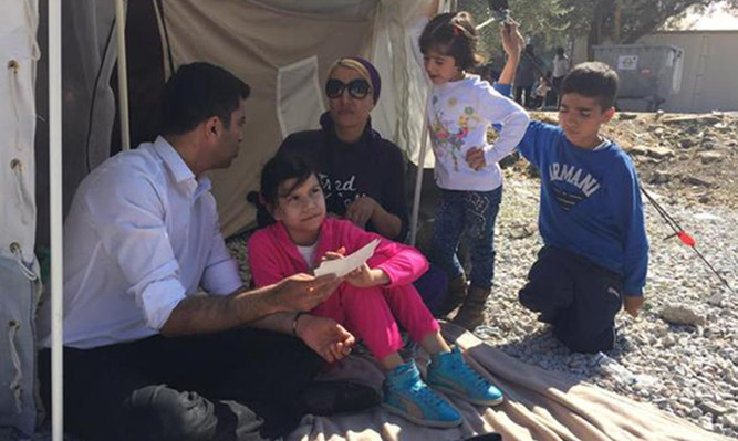 Humza Yousaf during a visit to the Greek island of Lesbos, where thousands of refugees arrive daily on their journey to Europe.