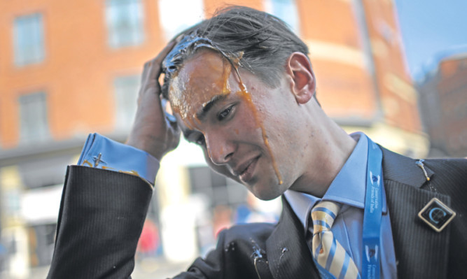A young Conservative was hit by an egg as he arrived for the first day of the partys conference in Manchester on Sunday.
