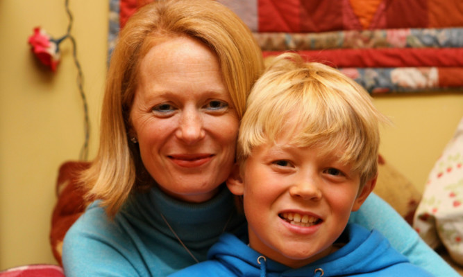 Elizabeth Logan with her son Bruce who was diagnosed with leukaemia as a toddler